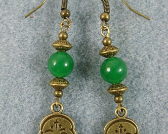 Dangle earrings with skulls and green beads