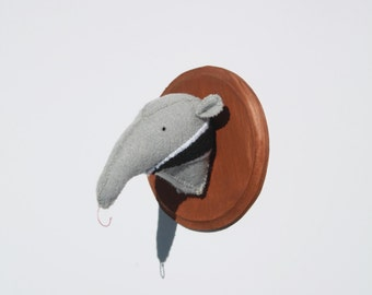 Anteater faux taxidermy on wooden mount