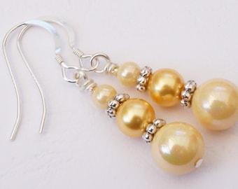 Yellow earrings, lemon earrings, shell pearl earrings, yellow pearl earrings, triple pearl earrings, graduated yellow pearl drop earrings