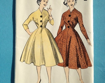 Vintage 1950s sewing pattern for Ladies fitted dress with full skirt