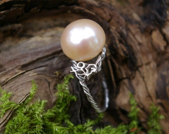 Pearl pink ring on his son white gold nest