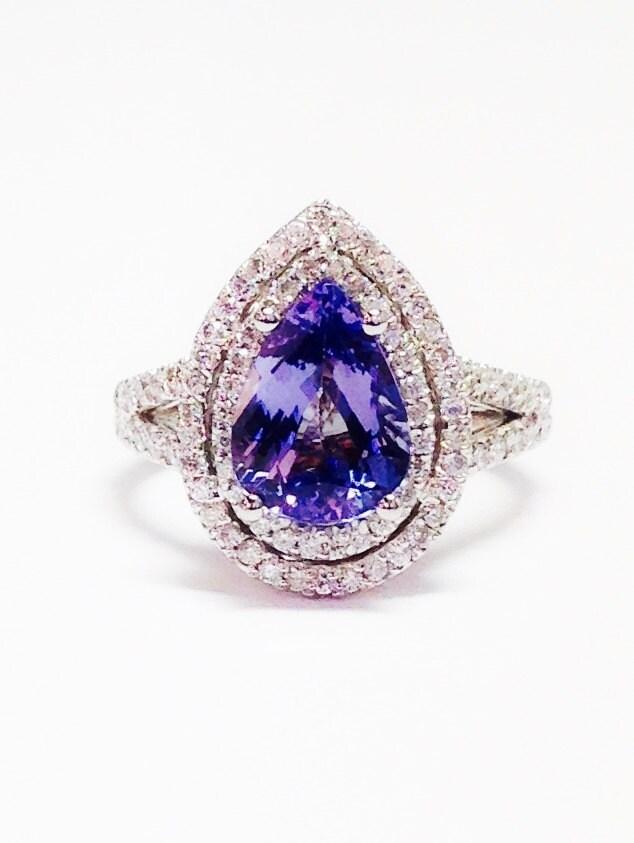 tanzanite gemstone ring pear shape halo deco