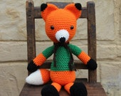 Handmade, crocheted toy fox for children and babies in orange, black, cream and green