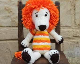 Handmade, crocheted toy lion for children and babies in cream, orange and yellow