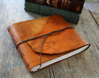 "Leather Sketchbook / Guestbook . 7.25"" high x 8.5"" wide. Handmade Handbound . hand-dyed tan (320pgs)"