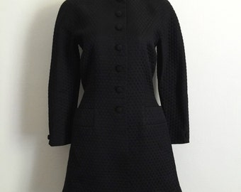 GENNY!!! Glamorous 1980s 'Genny' black panelled magyar sleeved jacket with flared hem / Made in Italy