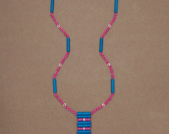 "Long beaded talisman necklace with cross pattern fringe in blue, pink & white ceramic beads. ""Ella"" from the Melody Collection"