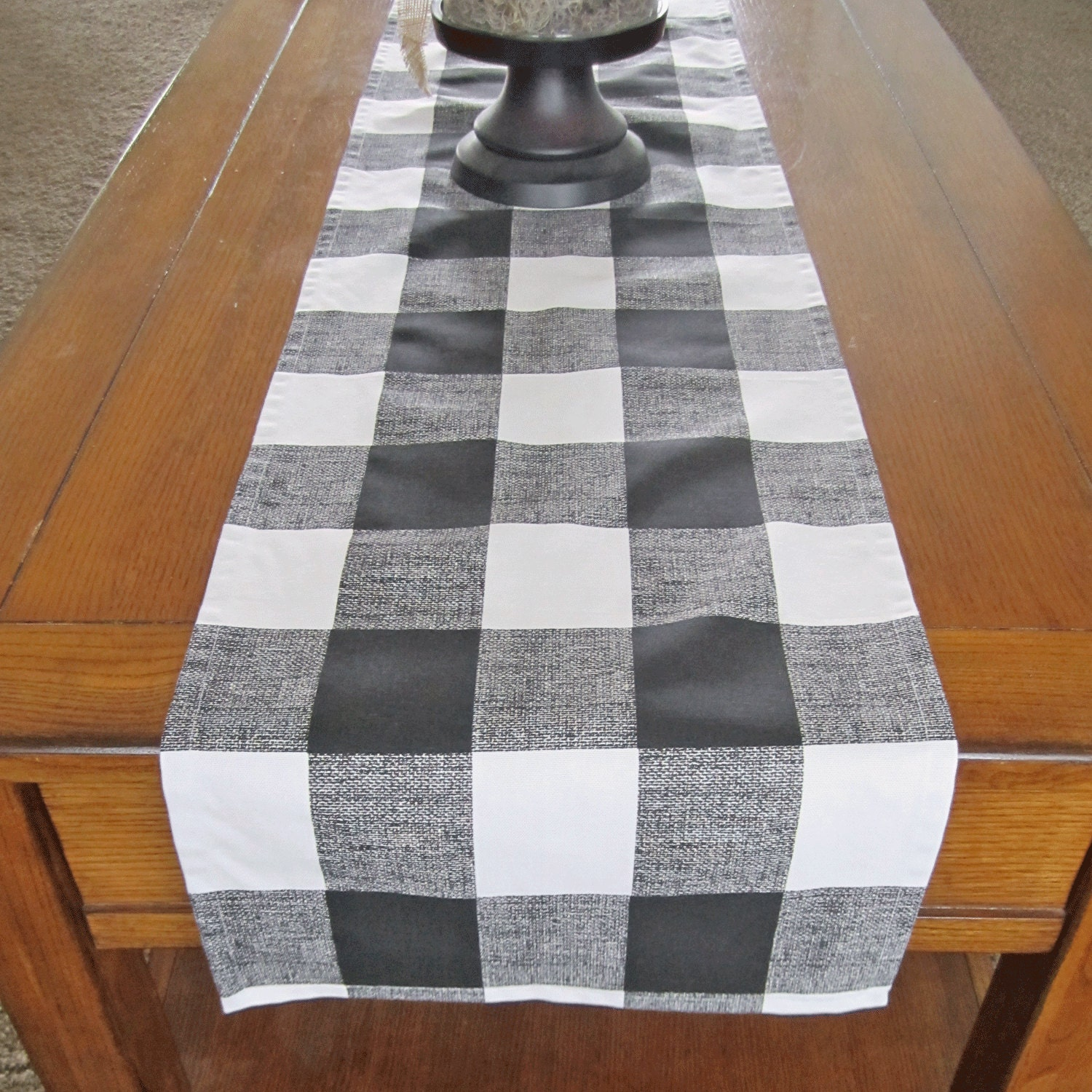 Black table runners can improve the aesthetic of a dining room table with next to no effort or cost. With options for every occasion, whether that is an elegant evening of fine dining or a wholesome Sunday night roast with the whole family, you're bound to find a table runner for your home within Wayfair.