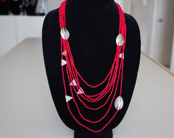 Unique, funky and one of a kind long, handcrafted necklace.