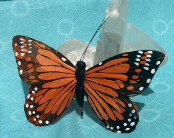 Orange butterfly hairclips Brett hair assessor