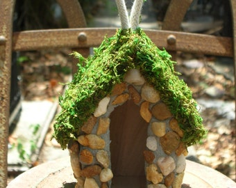 Fairy House in River Rocks and Preserved Moss
