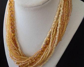 Beige Multi Strand Necklace
