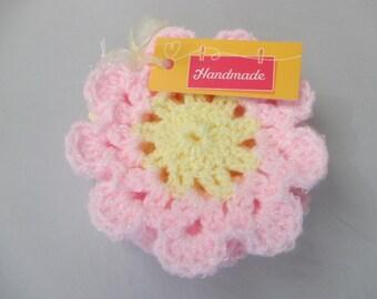 Pink crochet daisy coasters