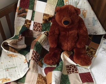 Handcrafted snuggly 100% cotton baby crib quilt.