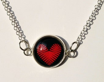 Red heart on black 14mm necklace