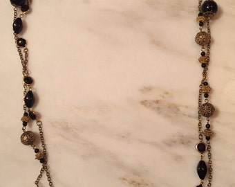 Vintage gold and black beaded chain necklace with black faceted stones