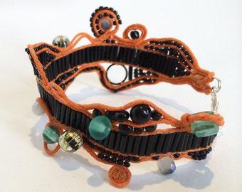 Black, orange and aqua beaded bracelet