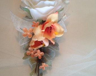 Wrist corsage, peach fresias. Prom corsage.
