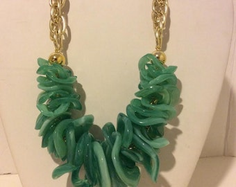 Chunky green and gold resin statement necklace