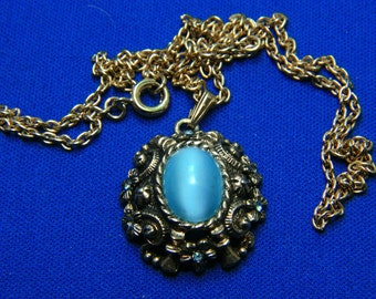 Vintage Sarah Coventry Ornate Gold Tone Moonglow Lucite and Aqua Rhinestone Pendant Necklace