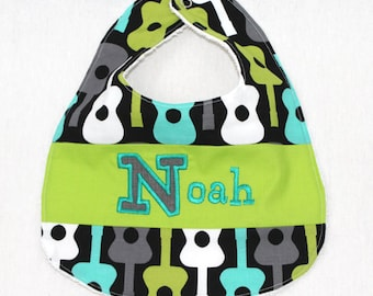 Custom Bib with baby name in Groovy Guitar fabric
