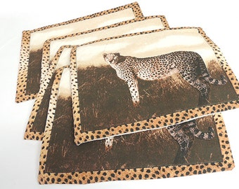 Handmade African art themed cloth placemats, set of 5. Leopard scene with leopard border.