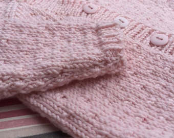 Pink baby cardigan in Debbie Bliss Cashmerino light pink