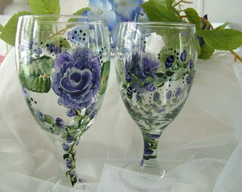 2 Glasses with blue roses hand painted.