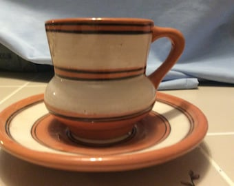 Vintage ceramic type cup and saucer