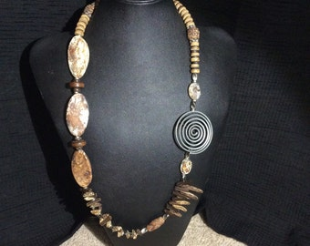 Handcrafted Asymmetrical  Necklace is made of Agate, Wood, Coconut shell, and metal.