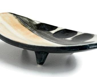 small ceramic three legged bowl