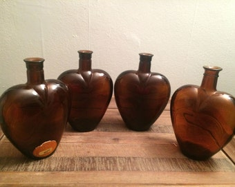 Four Brown Glass bottles