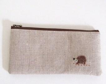 Flat  zipper pouch  - linen with a hedgehog applique