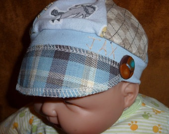 Infant Jax Hat in blues and brown with horse shoes and bucking bronc for infant 0-6 months