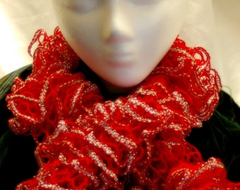 Hand knitted Ruffle Scarf in Ruby Red edged in Silver sparkling in the light.