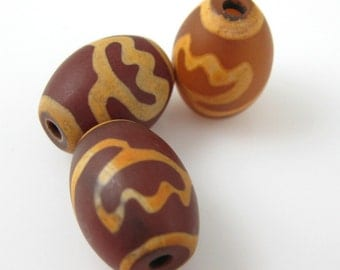 Carnelian dZi bead - Oval Shape with Lotus Body Totem -- 16 mm by 12 mm ( 3 pcs)- SKU: 302083