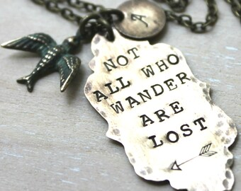 Brass Handstamped Ornate Tag, Arrow, and Bird. Not All Who Wander Are Lost. Personalized with initial
