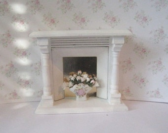A  Dollhouse Fireplace,  living room, bedroom furniture, white fireplace,   a dollhouse miniature in twelfth scale