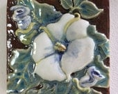 """Datura flower decorative tile with hanging wire.  Approx size 4"""" x 4"""""""