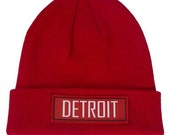 fold-over knit beanie with a Detroit Red Wings inspired patch