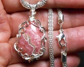 Rhodochrosite  drop cabochon pendant, hand wrapped silver  filigree setting