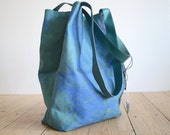 Green leather shopper with blue print