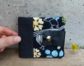 Black wallet for women with flowers. Floral wallet with bird. Fabric wallet in black with upcycled leather flap