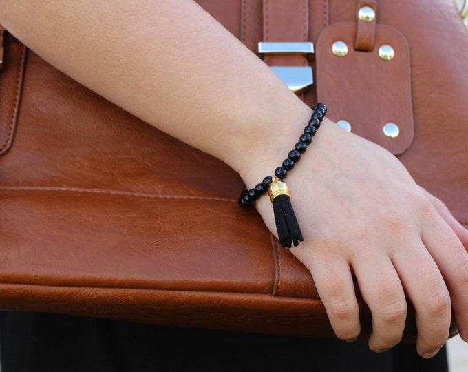 Black beaded tassel bracelet.