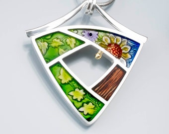 Ivy Woodrose sterling silver, pmc and resin window/portal pendant