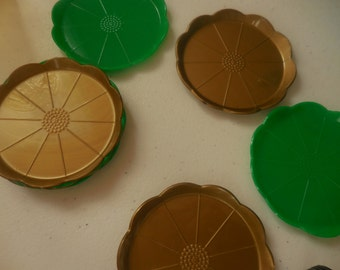 Eight Gold & Green Plastic Coasters by STEEDS