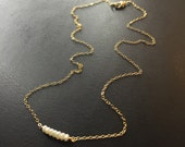 Dainty pearls on 14k gold chain