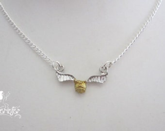 The Golden Snitch necklace inspired by Harry Potter