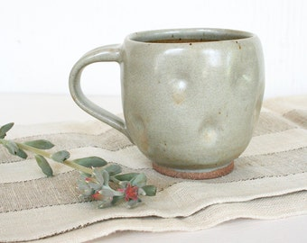 Altered stoneware cup in neutral colors. Honey, caramel, tan, oatmeal, off white, natural, rustic, hand made, vitreous, functional