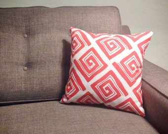 Two sided grey and tangerine accent pillow